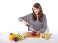 Free Woman Cutting An Apple Royalty Free Stock Images - 10314669