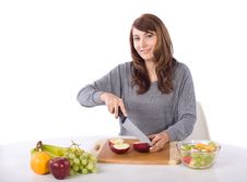 Free Woman Cutting An Apple Stock Photography - 10314692