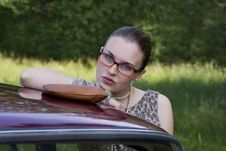 Free Beautiful Girl In Glasses At The Car Royalty Free Stock Photo - 10319795