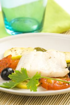 Fillet Of Cod Baked Tomatoes Zucchini Black Olives Royalty Free Stock Photos