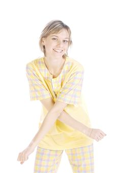 Playful Teenager In A Yellow Pajama Royalty Free Stock Images
