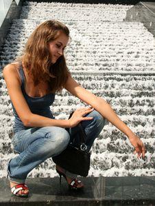 Girl Sitting Near Fountain Stock Photo