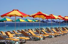 Free Beach With Beds And Umbrellas Royalty Free Stock Photo - 10325385