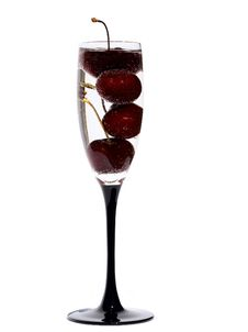 Free The Glass With Cherry In Water Stock Image - 10325821