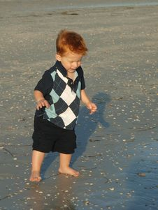 Free Little Boy On The Beach Alone Stock Images - 10326964