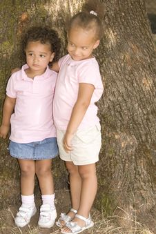 Two Young Ethnic Sisters Stock Image