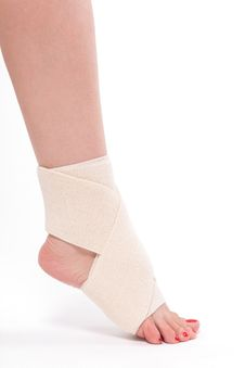 Free Women`s Leg Tied With An Elastic Bandage, Ankle Foot Stock Images - 103281354