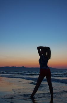 Free Silhouette Of A Woman On A Beach Stock Photo - 10330300