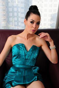 Free Brunette Wearing Turquoise Dress Royalty Free Stock Photos - 10333248