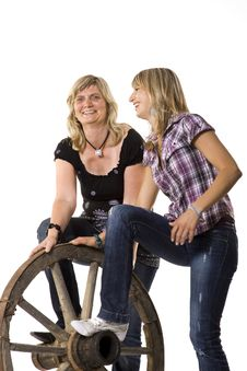 Mother And Daughter With Car-wheel Royalty Free Stock Photography