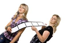 Mother And Daughter Holding Film Strip Stock Photography