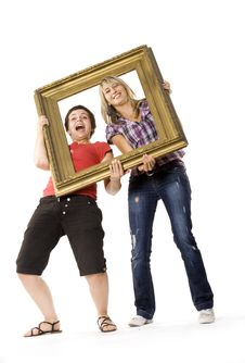 Free Young Women Posing With Picture Frame Royalty Free Stock Photography - 10334217
