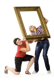 Young Women Holding Wooden Frame Stock Photo