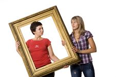 Free Young Women Holding Wooden Frame Stock Photo - 10334230
