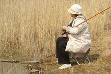 Free The Woman Fishs On Coast Of Lake Stock Image - 10335811