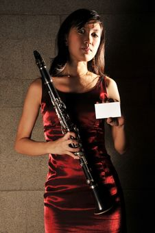 Free Beautiful Woman Holding To Musical Instrument Royalty Free Stock Photography - 10336217