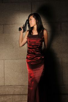 Free Woman Holding A Revolver In An Underground Tunnel Royalty Free Stock Photos - 10336298