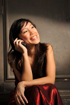 Beautiful Young Asian Woman With Mobile Phone Royalty Free Stock Image