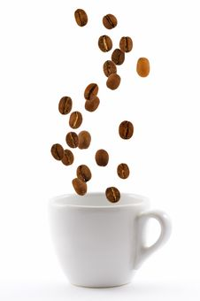 Cup With Coffe Beans Stock Photos