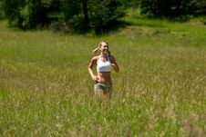 Free Summer - Young Woman Jogging In A Meadow Royalty Free Stock Image - 10337356