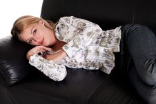 Free Beautiful Blond Girl Resting On The Couch Stock Photos - 10337403