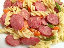 Fusilli With Hot Dog Slices And Vegetables Royalty Free Stock Images