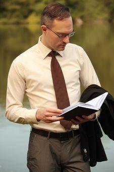 Businessman Looking In His Organizer Stock Photos