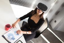 Good Looking Young Business Lady In Black Strong Suite Sit At The Office Table In Vr Glasses Royalty Free Stock Photo
