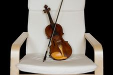 Free Violin Resting On A Chair Stock Image - 10340961