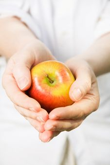 Free Woman S Hands Holding A Ripe Apple Royalty Free Stock Photos - 10340978