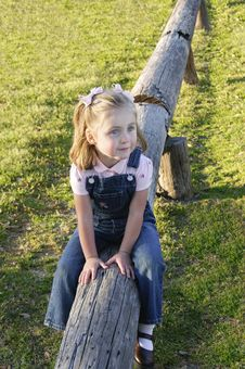 Free C - Small Girl Sitting On Log 1 Royalty Free Stock Photography - 10344607