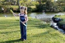 Free C - Small Girl With Bubbles 1 Stock Image - 10344621
