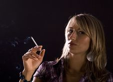 Free Young Woman Smoking Stock Photography - 10345292