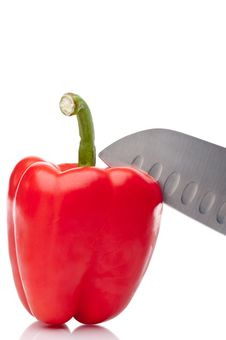Free A Red Pepper Being Sliced On White Stock Photos - 10347103
