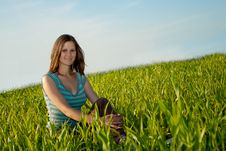 Free Woman Sitting On Grass Royalty Free Stock Photo - 10348285
