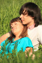 Free Girl Lies On Guy Sitting In Grass Stock Photography - 10355102