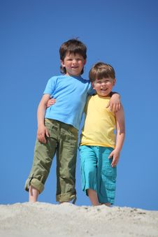 Free Two Boys Embrace Each Other On Sand Stock Photography - 10354122
