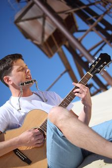 Free Guy Plays Guitar And  Lip Accordion Royalty Free Stock Images - 10354419