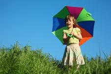 Girl With  Multicoloured Umbrella In Grass Stock Photos