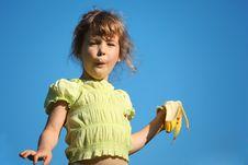 Free Girl Eats Banana Against Blue Sky Royalty Free Stock Images - 10354629