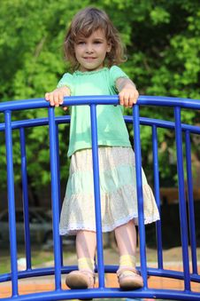 Girl Stands On Bridge On Playground Stock Photography