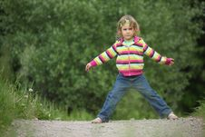 Girl Makes Gymnastic In Park Royalty Free Stock Photography