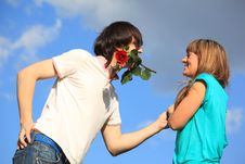 Free Guy With Rose In Mouth And Girl Against Sky Stock Image - 10355041