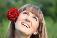 Girl With Rose In Hair Looks Upwards Stock Images