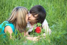 Young Pair Kissing In Grass