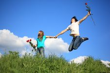 Free Guy Jumps Holding Girl With Roses Royalty Free Stock Photo - 10355115