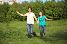 Free Smiling Pair Runs, Keeping For Hands, In Park Royalty Free Stock Image - 10355236