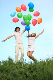Free Girl And Guy Start Multi-coloured Balloons Stock Image - 10355371
