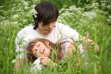 Free Girl Lies In Lap Of Guy Sitting In Grass Royalty Free Stock Photography - 10355407