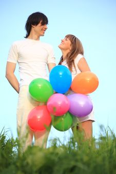 Free Girl And Guy Stand With Balloons Royalty Free Stock Images - 10355639